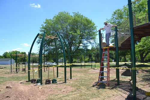 Photo by Tom Rivers: Scott Baker, owner of Park & Play in Cazenovia, installs new playground equipment at Bullard Park last June. A state grant from Sen. Rob Ortt for $50,000 paid for about half the cost of that equipment.