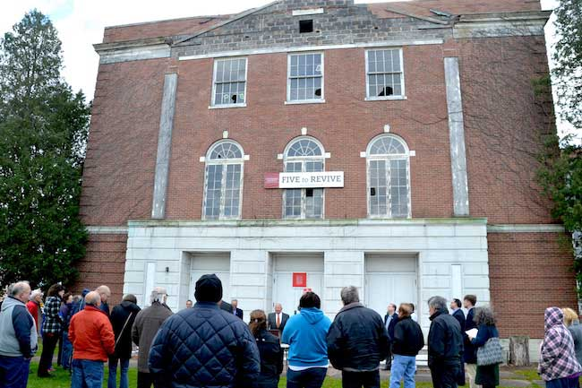 Nelson Leenhouts, chairman and CEO of Home Leasing, addresses a crowd on Nov. 11 outside the former Holley High School. Leenhouts wants to redevelop the site into senior apartments and the village offices.