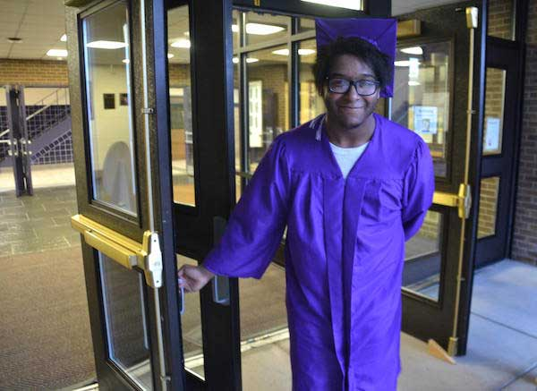 Photo by Tom Rivers Devin Ware is pictured after graduation Friday by the main doors leading into the high school. Ware was at school at 7 most mornings ... & Albion grad showed up very early at high school for 4 years ... pezcame.com