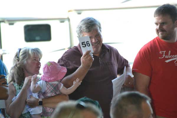Big bids push 4 h market auction past 20k orleans hub jim panek of panek farms bids on ryle lears steer he is joined by his wife kerry their 6 month old granddaughter emily klotzbach and son phil thecheapjerseys Images